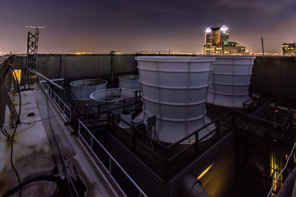 Image of giant chimneys in Dallas, Texas, taken while rooftopping at night.