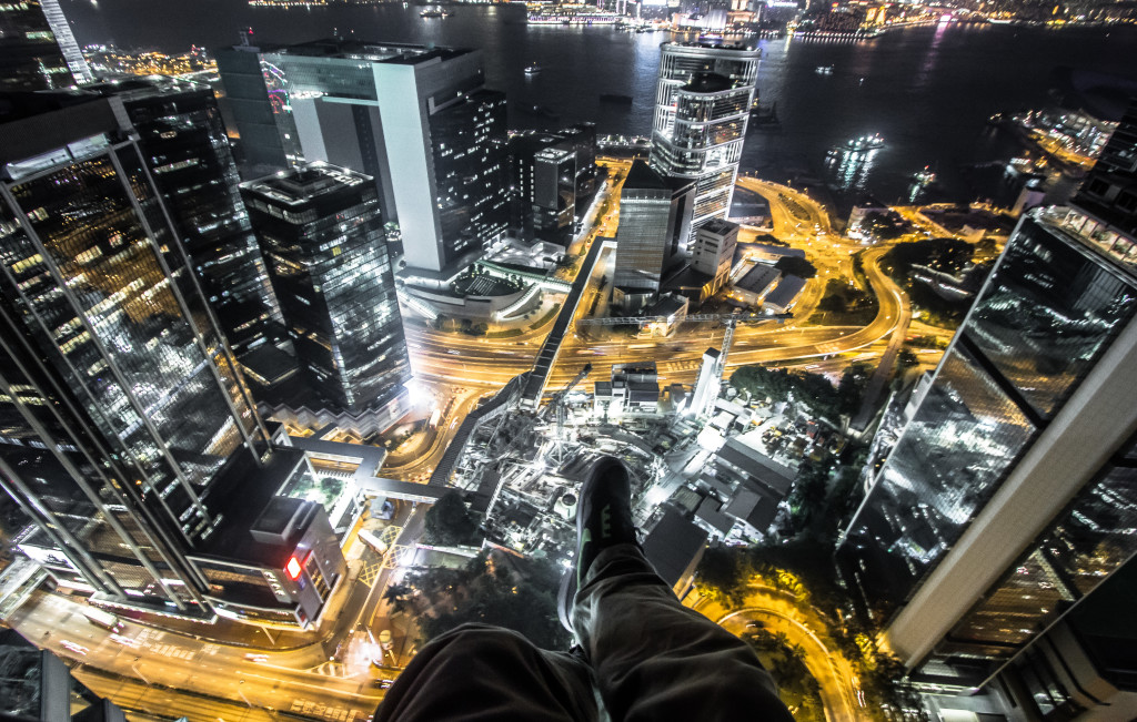 Rooftopping in Hong Kong, sitting on a building at night