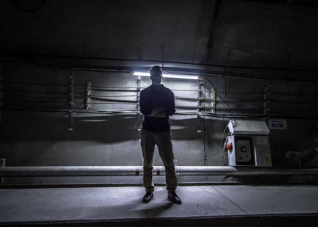 Photo of a guy taken underground while exploring the Hong Kong Metro.