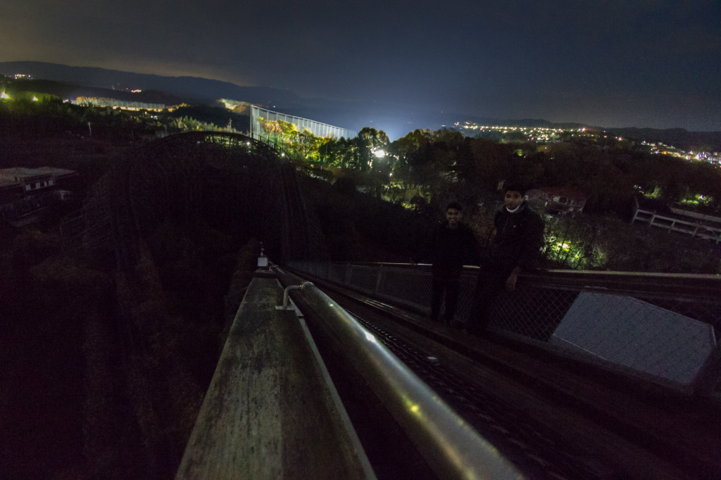 An image from the top of the rollercoaster Aska at night, taken while exploring Nara Dreamland in Japan.