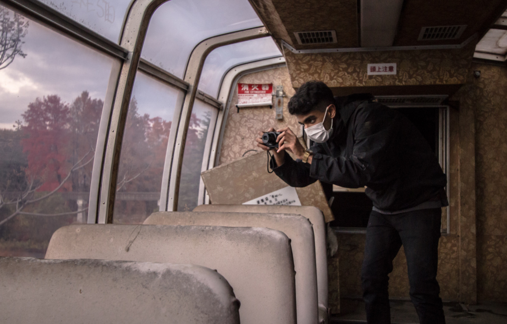 Taking a photo inside the train at Nara Dreamland in Japan