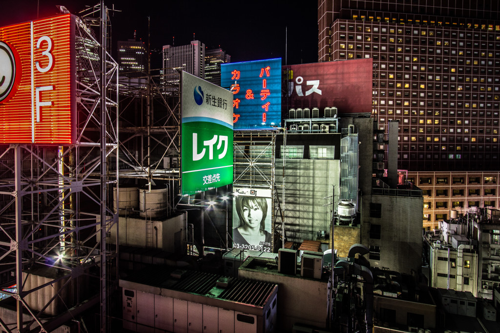 An image of billboards and signs in Tokyo, Japan at night.