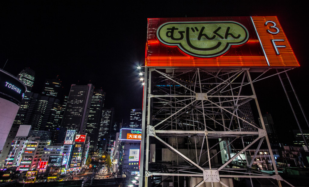 Illuminated neon sign in Tokyo at night.