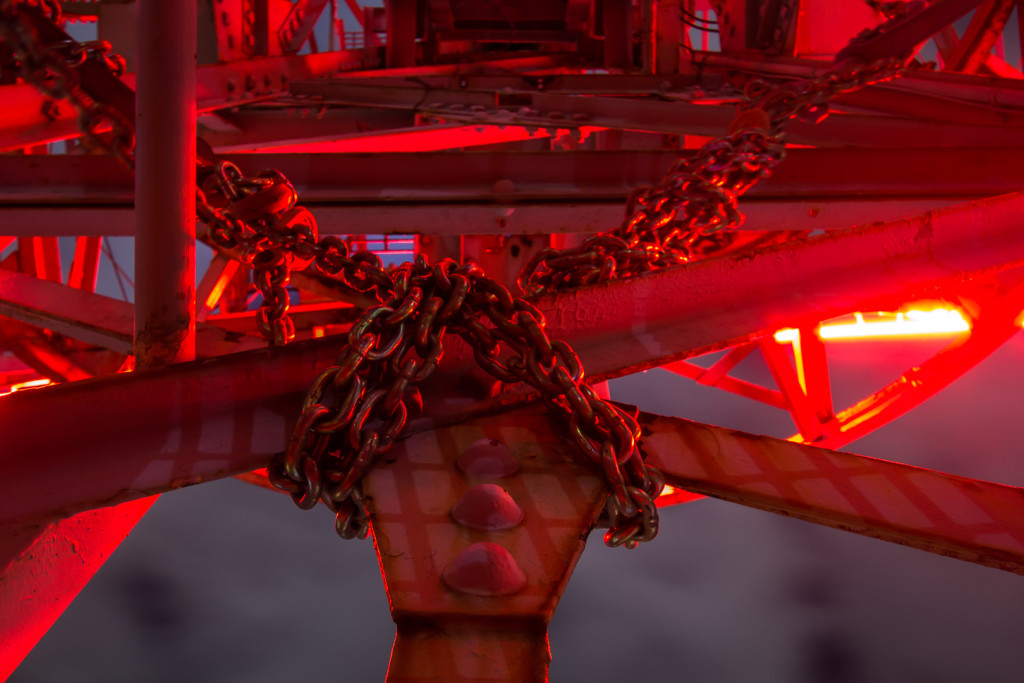 Chains strapped to a platform; taken while rooftopping in Dallas, Texas