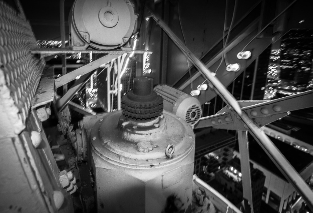 Black and white image of a gear used to rotate a sign
