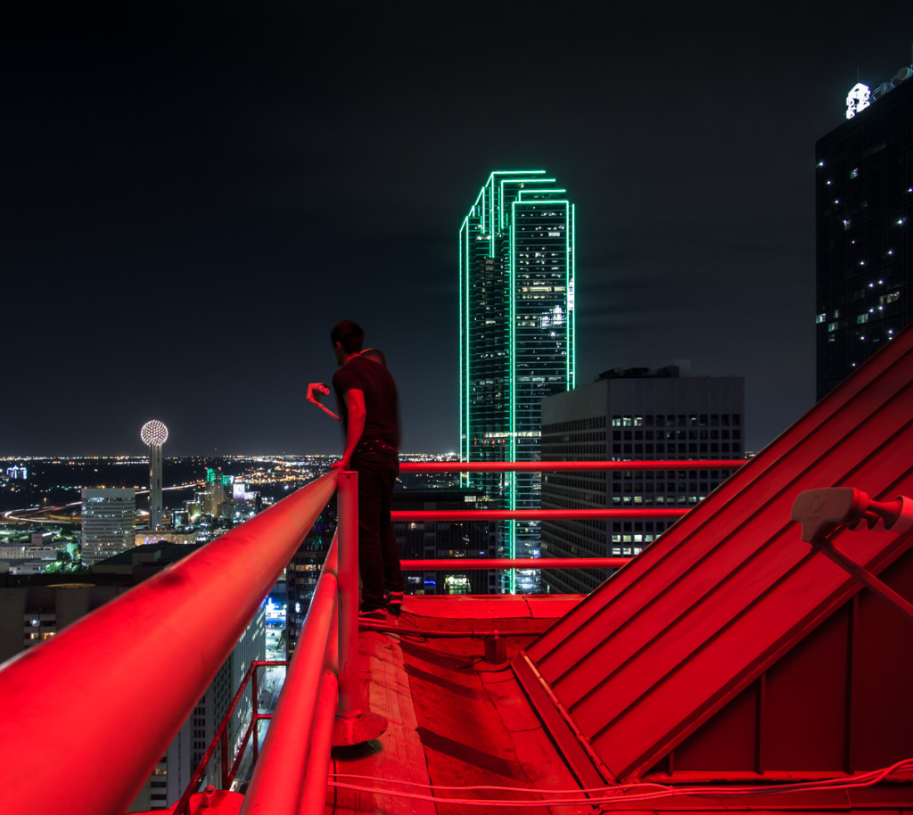 Overlooking downtown while rooftopping in Dallas