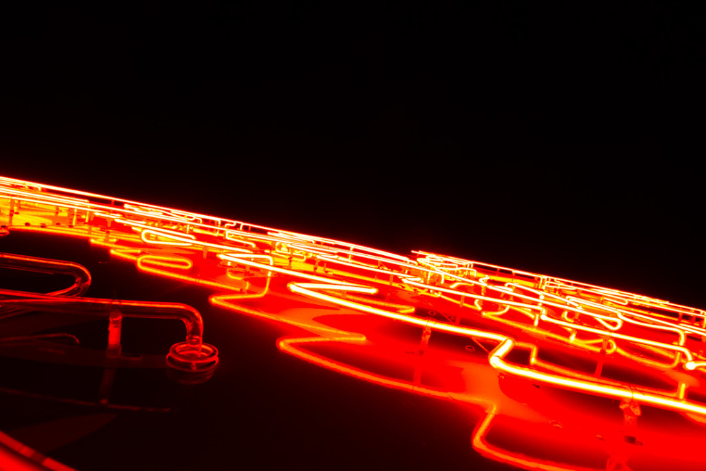 Close-up shot of a neon sign in downtown Dallas