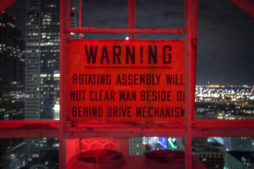 Warning sign at night in Dallas, TX