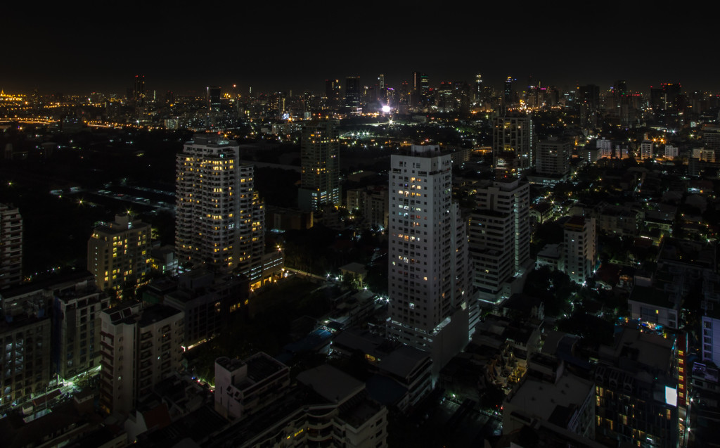 Cityscape of Bangkok, Thailand at night; taken while rooftopping