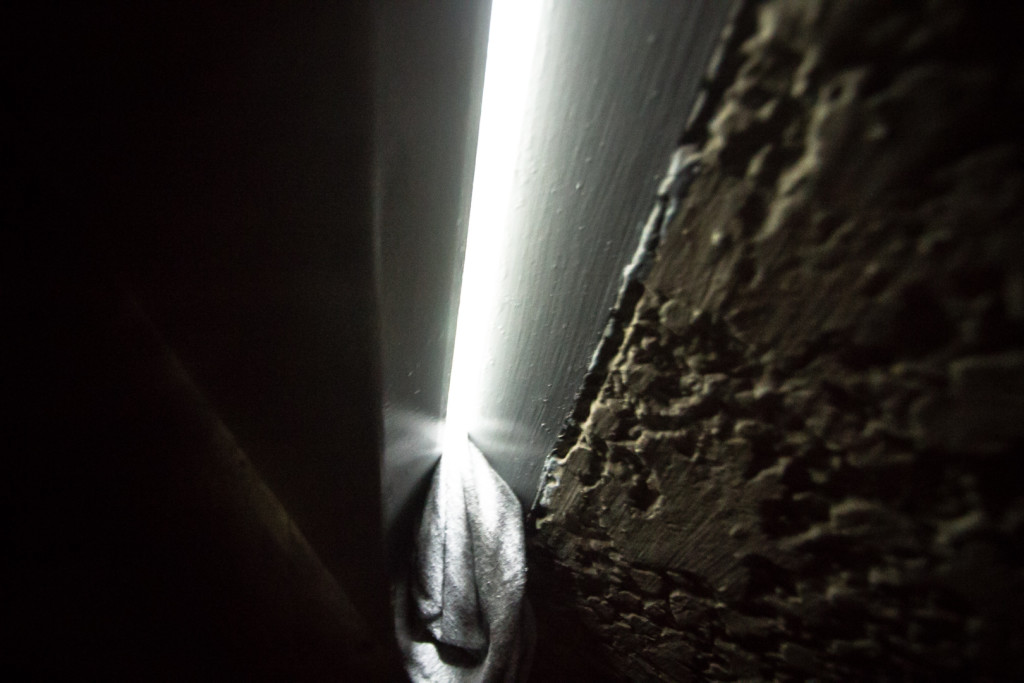 Image of door held open at night