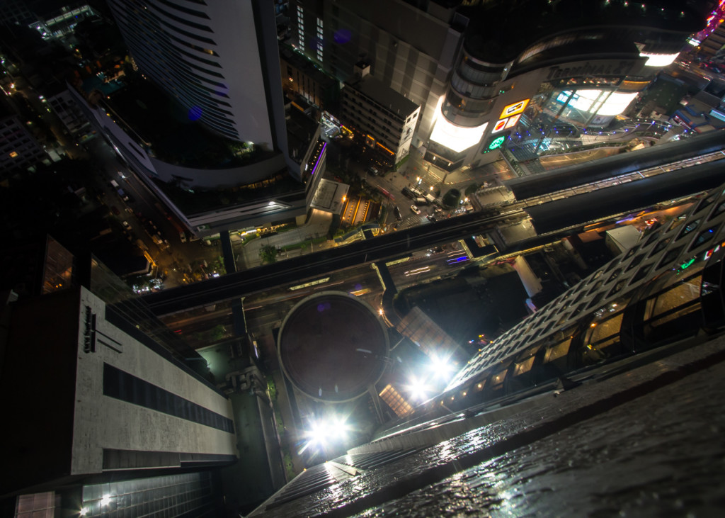 Looking downwards while rooftopping in Bangkok at night
