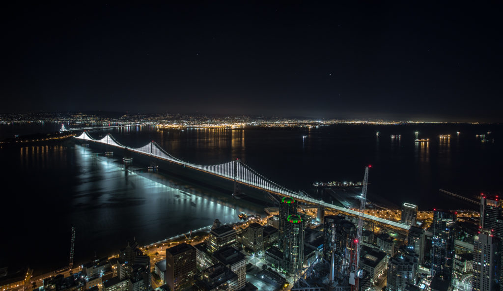 Bay Bridge as seen from a skyscraper while rooftopping in San Francisco