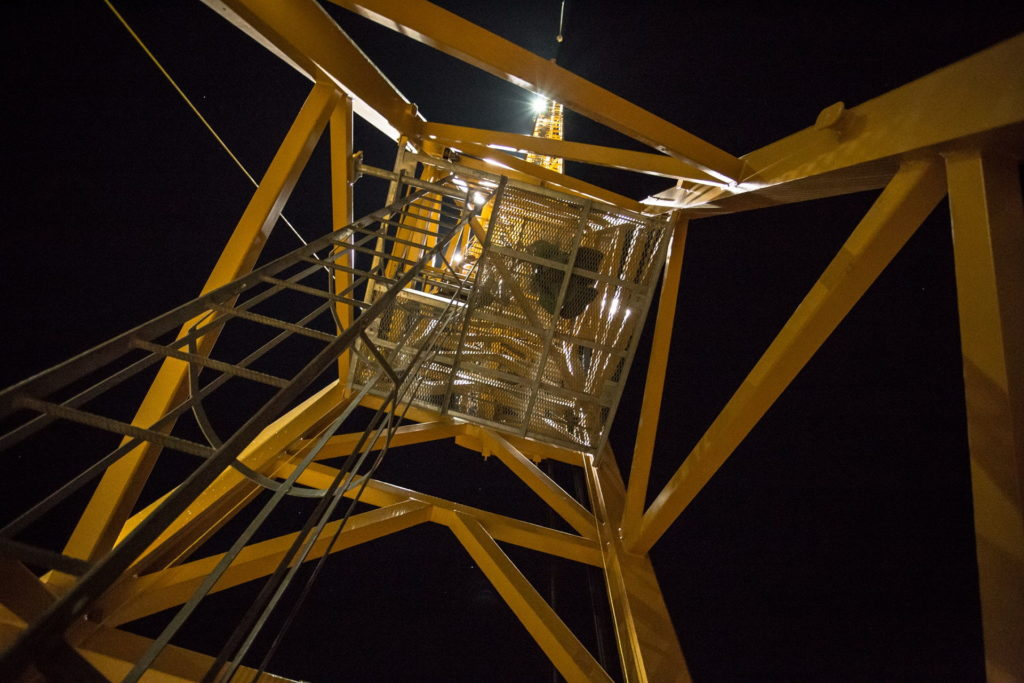 Night view climbing a crane