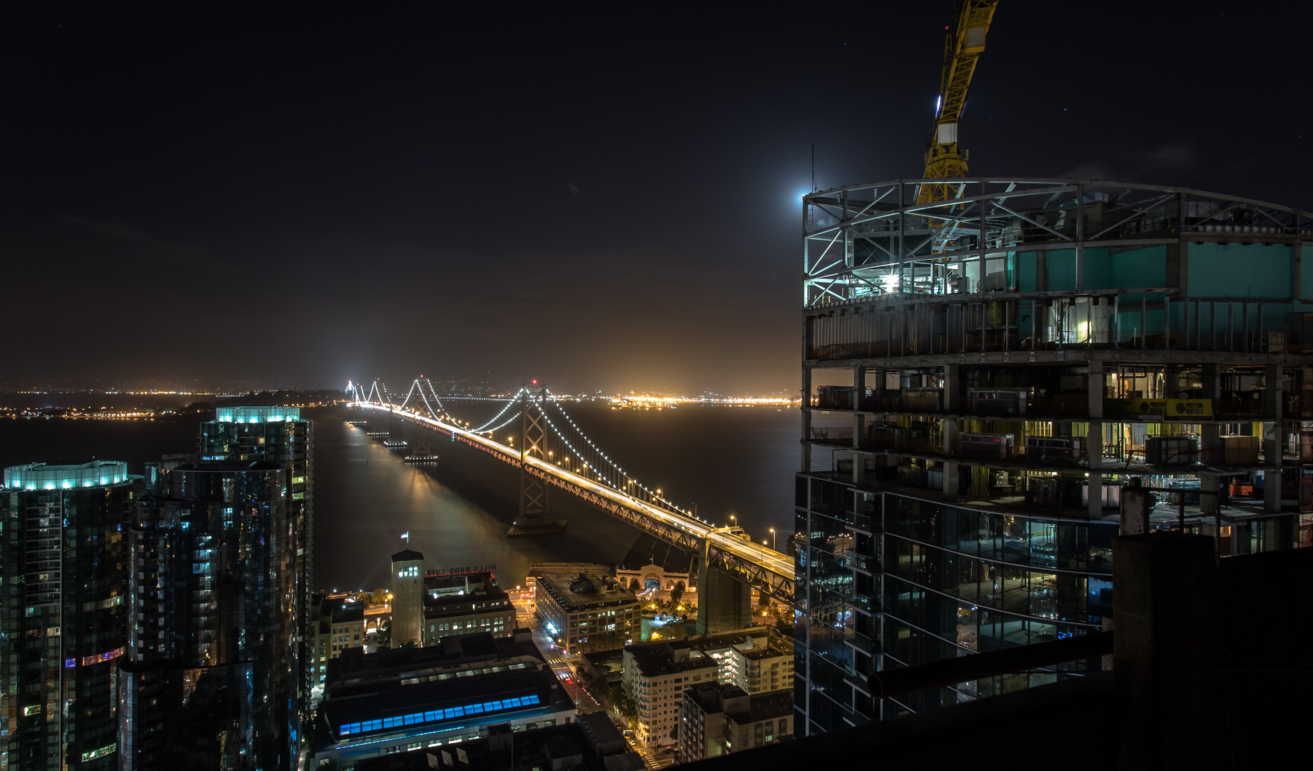 The Bay Bridge at night while rooftopping in San Francisco