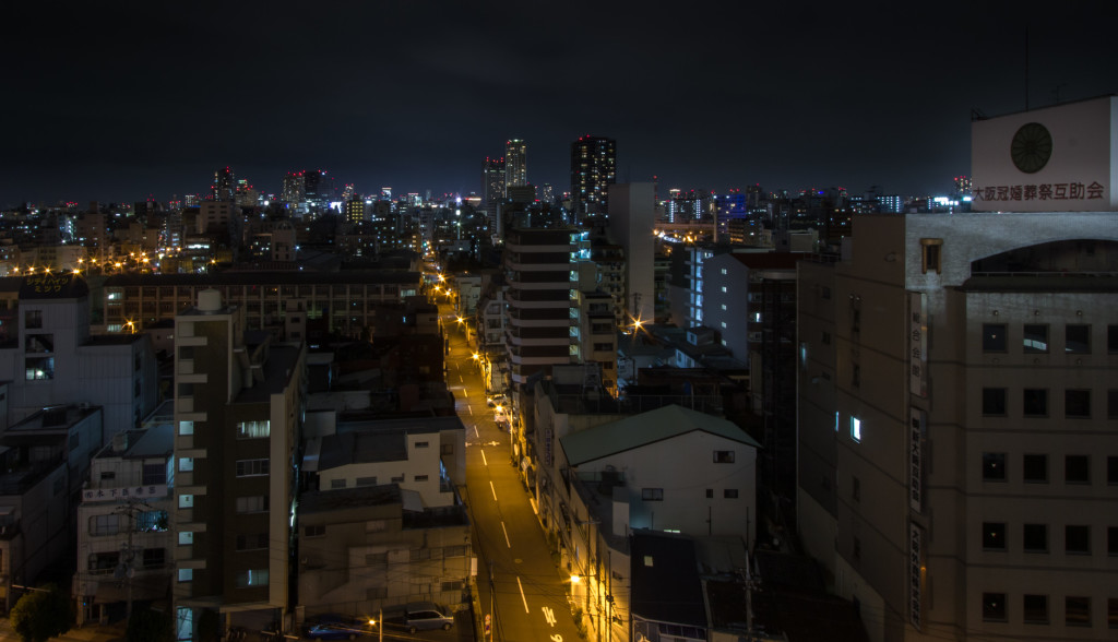 Street view at Nishinari, taken while rooftopping in Osaka, Japan at night
