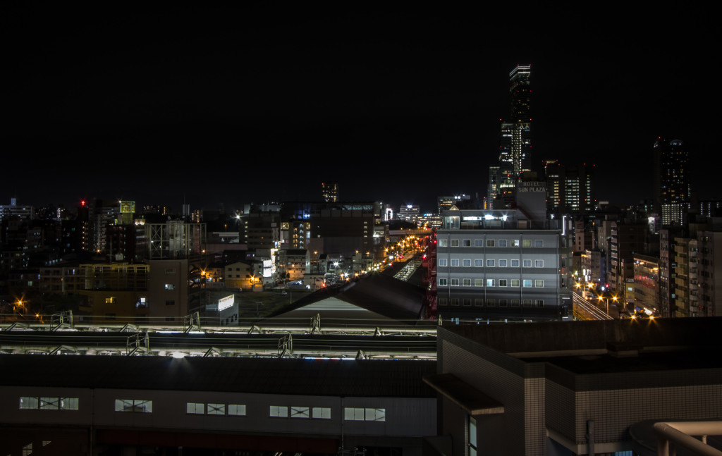Image at night of Shinimamiya station, taken while rooftopping