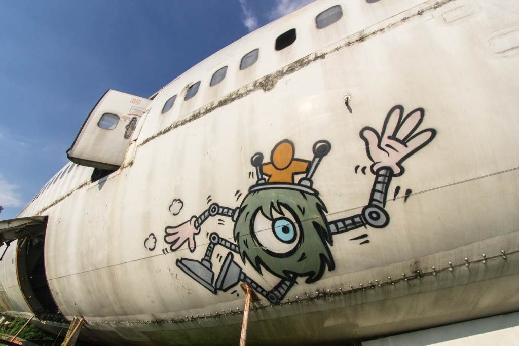 Close-up of graffiti on an abandoned Boeing 747