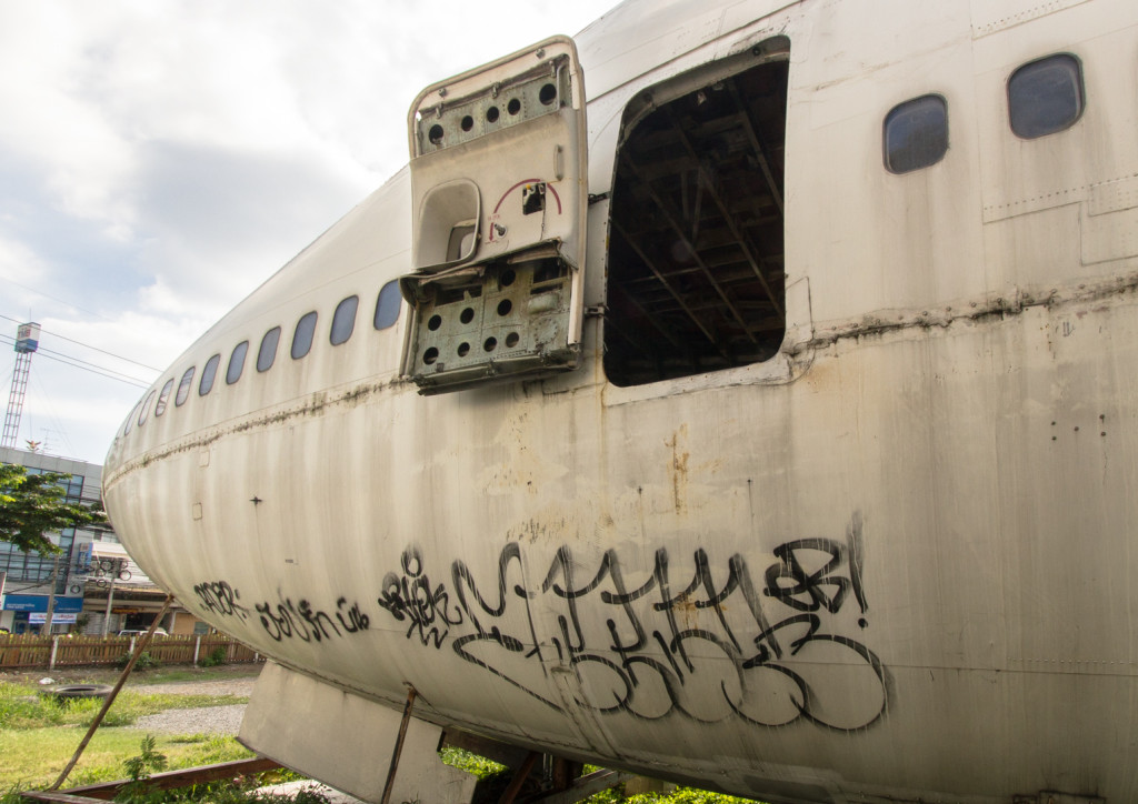 Open door of a Boeing 747 during an urbex in Bangkok, Thailand