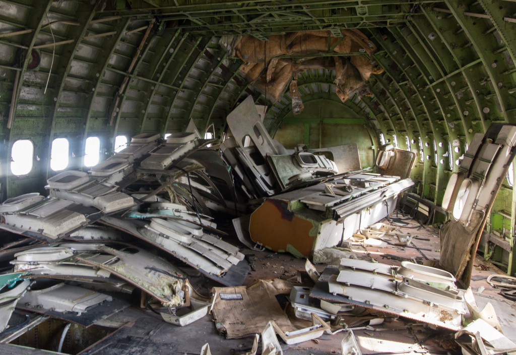 Pile of window paneling inside an abandoned airplane in Bangkok, Thailand