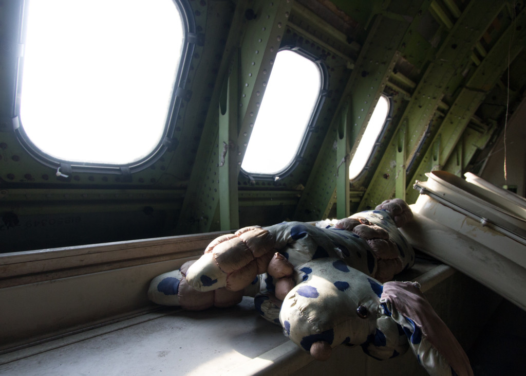 A stuffed animal inside an abandoned Boeing 747 jumbo jet in Bangkok, Thailand
