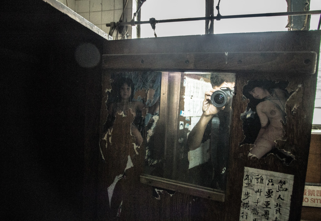 XXX photographs, on a locker in an abandoned area in Hong Kong
